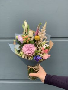 colourful flower bouquet in hand